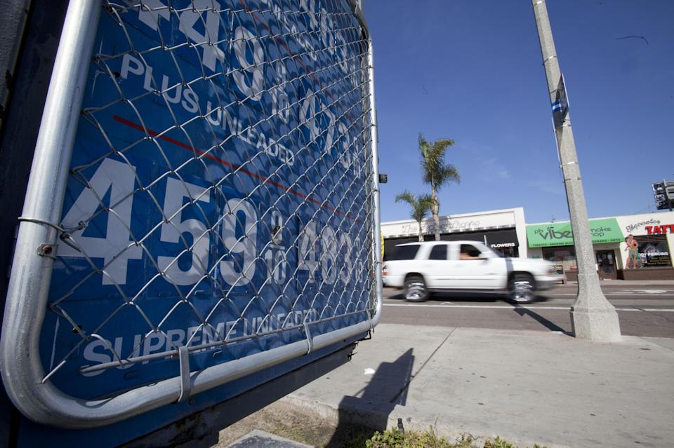 A sign displays gas prices at a gas station Friday, Feb. 17, 2012, in San Diego. Some analysts are starting to worry that rising fuel costs will undermine consumer spending and stymie economic growth. (AP Photo/Gregory Bull)