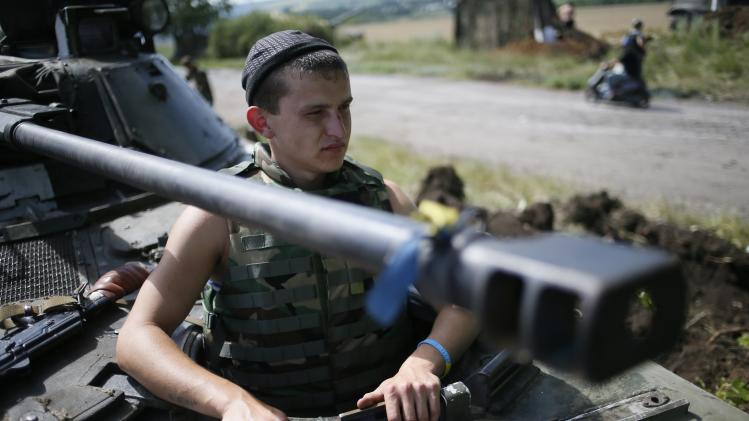 A Ukrainian soldier looks out from an armoured vehicle at a position about 60 km from Donetsk