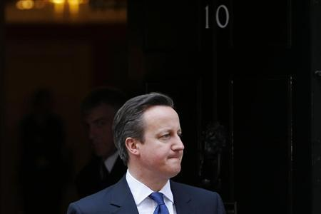 Britain's Prime Minister David Cameron awaits the arrival of Ireland's President Michael D. Higgins at Number 10 Downing Street in London
