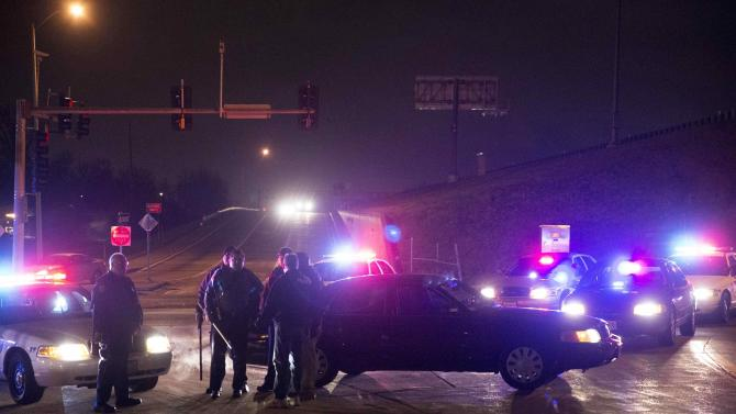 Police officers guard a highway onramp, during a protest after a man was fatally shot by a police man in Berkeley, Missouri