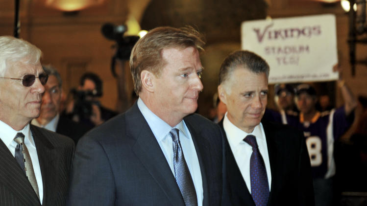 NFL commissioner Roger Goodell, center,  and Pittsburgh Steelers owner Art Rooney, arrive at the Minnesota State Capitol to meet with Gov. Mark Dayton and lawmakers in a push for a new Minnesota Vikings football stadium Friday, April 20, 2012 in St. Paul, Minn. Unidentified man at left is Vikings security. (AP Photo/Jim Mone,File)
