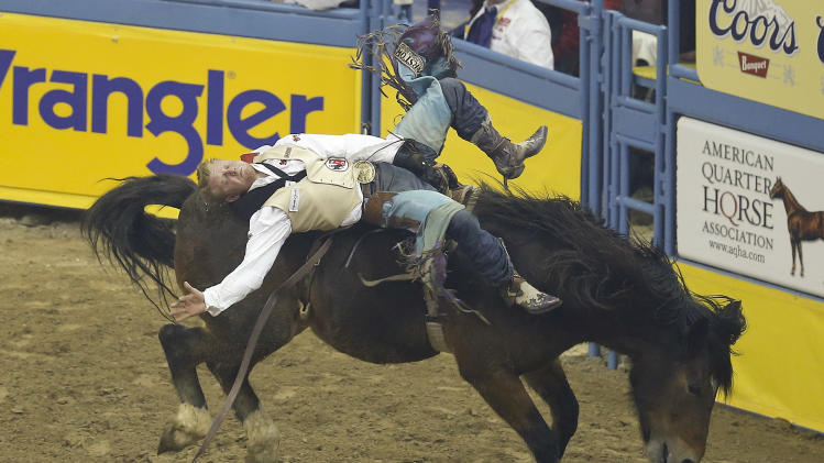 J.R. Vezain of Cowley, Texas stays atop Top Flight in the10th go-round of bareback riding event of the National Finals Rodeo, Saturday, Dec. 15, 2012, in Las Vegas. (AP Photo/Julie Jacobson)