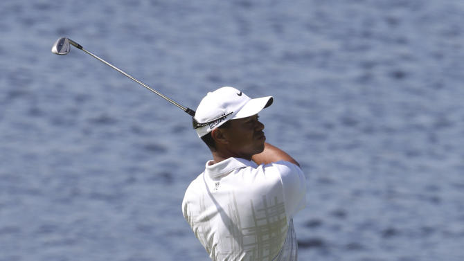 U.S. golfer Tiger Woods plays a shot on the 17th fairway during the second round of the Australian Open golf tournament in Sydney, Australia, Friday, Nov. 11, 2011. Woods started the second round at 4 under the card.(AP Photo/Rob Griffith)