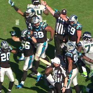 Carolina Panthers defensive end Mario Addison recovers Russell Wilson's fumbled ball