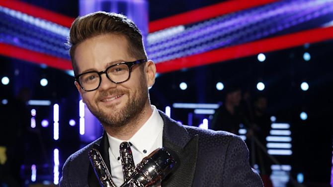 """In this May 20, 2014 photo released by NBC, Josh Kaufman hold his trophy after winning the singing competition series """"The Voice,"""" in Los Angeles. Kaufman said Thursday, Sept. 18, he'll be taking a turn as the lead in the Tony Award-winning revival """"Pippin.""""  The 38-year-old Indianapolis resident, a former SAT prep tutor and father of three,  will join """"Pippin"""" from Nov. 4-Jan. 4 at the Music Box Theatre.   (AP Photo/NBC, Trae Patton)"""