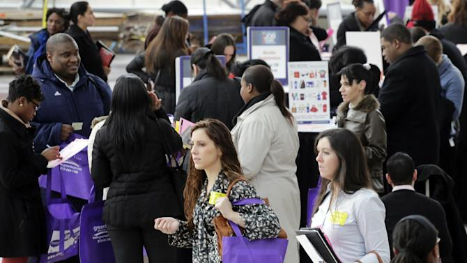 FILE - In this March 14, 2013, file photo, job seekers attend a health care job fair in New York. A new Associated Press-GfK poll finds that only 1 in 4 Americans now expects his or her own financial situation to improve over the next year. The sour mood is undermining support for President Barack Obama's economic stewardship and for government in general. The poll shows that just 46 percent of Americans approve of Obama's handling of the economy; 52 percent disapprove. (AP Photo/Mark Lennihan, File)