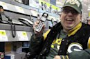 Sean Irvin browses phones at a Best Buy store Monday, Sept. 17, 2012, in Anchorage, Alaska. It's one of the ways Irvin plans to spend his yearly Alaska Permanent Fund dividend, whose amount was being announced Tuesday. (AP Photo/Rachel D'Oro)