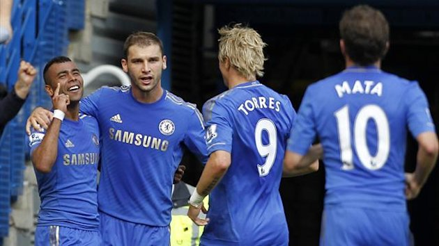 Chelsea celebrate Ashley Cole's winner against Stoke, September 2012