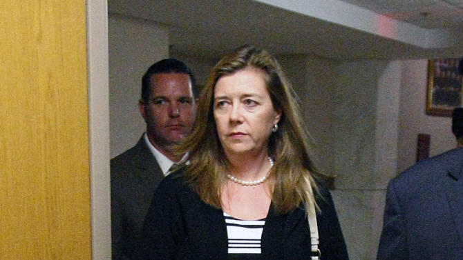Melanie Capobianco and Matt Capobianco, background, leave a courtroom after a hearing Wednesday, Sept. 4, 2013 at the Muskogee County Courthouse in Muskogee, Okla. Oklahoma Gov. Mary Fallin on Wednesday signed an extradition order to send the father of a Cherokee girl in the middle of a custody dispute to South Carolina to face a criminal charge for refusing to hand his 3-year-old daughter over to her adoptive parents. (AP Photo/Tulsa World, Matt Barnard) TV OUT; TULSA OUT