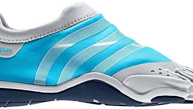 In this product Image provided by Adidas, the Adipure Trainer W, in intense blue and metallic silver, is shown. Adidas is trying to tap into the growing niche U.S. market of people who want to run in shoes that mimic the experience of running barefoot, but offer the protection, traction and durability of traditional athletic shoes. (AP Photo/Adidas)