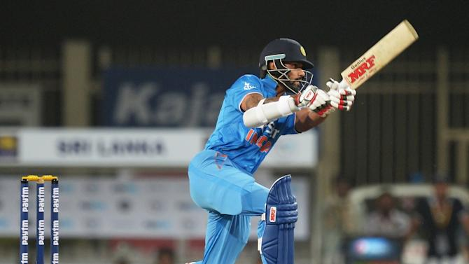 India's Shikhar Dhawan plays a shot during the second T20 international match between India and Sri Lanka at the Jharkhand State Cricket Association International Stadium Complex in Ranchi on February 12, 2016