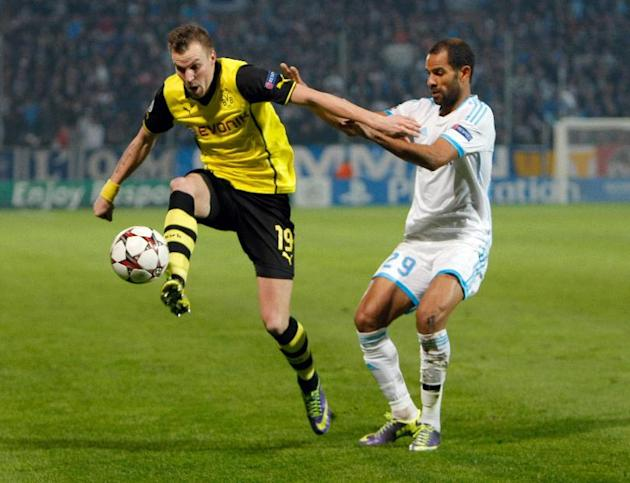 Dortmund's Kevin Grosskreutz, left, controls the ball while Marseille's Saber Khalifa looks on during the Group F Champions League soccer match between Olympique Marseille and Borussia Dortmun