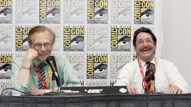 COMMERCIAL IMAGE - Larry King, left, interviews Peter Cullen during the Transformers Prime panel at Comic-Con on Friday, July 13, 2012, in San Diego, Calif. (Photo by Todd Williamson/Invision for The Hub/AP Images)
