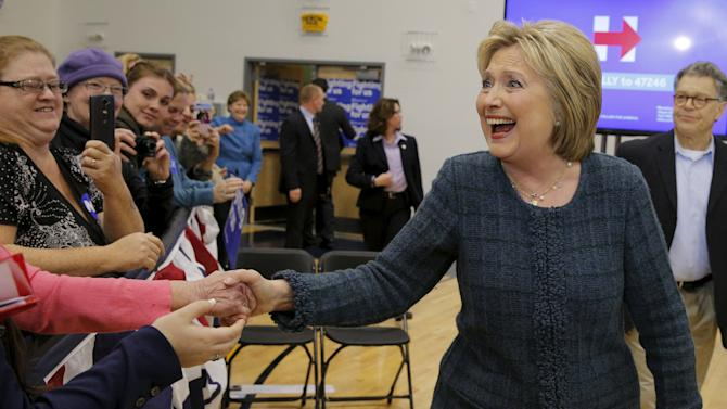 U.S. Democratic presidential candidate Hillary Clinton takes the stage at a campaign rally in Portsmouth