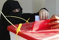 A Libyan woman casts her ballot at a polling station in the eastern city of Benghazi during Libya's General National Assembly election on July 7. Liberals appeared to have the edge on Islamists as a key figure in the revolt that ousted Moamer Kadhafi urged national unity on Monday with Libya still days away from the final results of its first free poll in decades