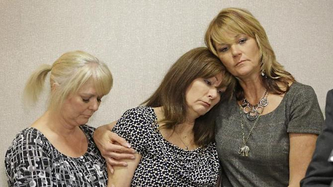 Susan Hunt, center, the mother of Darrien Hunt, is consoled by her sisters Barbara Huston, left, and Cynthia Moss, during a news conference Friday, Sept. 19, 2014, in Salt Lake City. An attorney for the family of Darrien Hunt, a black 22-year-old who was fatally shot by Utah police, says he is going to ask the Department of Justice and FBI to investigate the shooting and reports of racial discrimination in the Salt Lake City suburb of Saratoga Springs where it occurred. (AP Photo/Rick Bowmer)