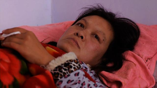 China couple devastated by alleged forced abortion