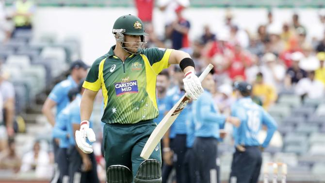 Australia's Aaron Finch leaves the field after being dismissed for a duck against England during their One Day International tri-series cricket final match at the WACA ground