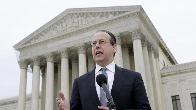 """FILE - In this March 28, 2012, file photo Paul Clement, the lawyer representing states opposed to the Patient Protection and Affordable Care Act, talks to media outside the Supreme Court in Washington at the end of arguments on the law's constitutionality. Chances are bleak that Congress would act to restore any parts of the law that the court might strike down, one reason why Justice Ruth Bader Ginsburg told Clement, """"So why should we say, it's a choice between a wrecking operation, which is what you are requesting, or a salvage job."""" She added, """"And the more conservative approach would be salvage rather than throwing out everything."""" (AP Photo/Charles Dharapak, File)"""