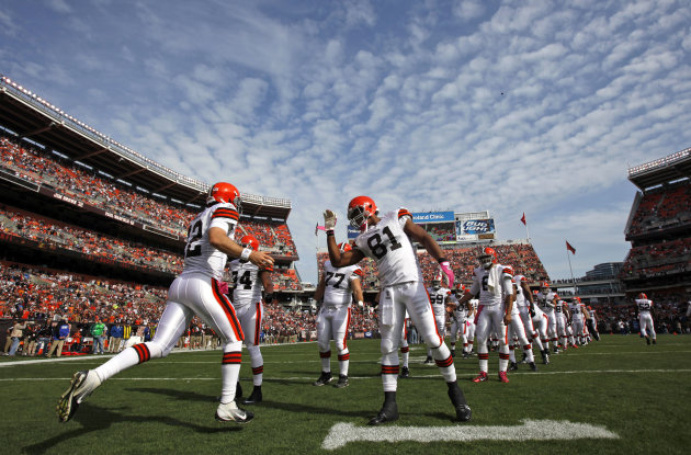FILE - In this Oct. 23, 2011, file photo, Cleveland Browns&#39; quarterback Colt McCoy (12) is greeted by his team during player introductions before taking on the Seattle Seahawks in an NFL football game in Cleveland. Browns owner Randy Lerner has reached a deal to sell the team to Tennessee truck-stop magnate Jimmy Haslam III, according to multiple reports on Thursday, Aug. 2, 2012. ESPN and the NFL Network said Thursday that an agreement on the team sale had been reached. ESPN said the sale price was for more than $1 billion. (AP Photo/Amy Sancetta, File)