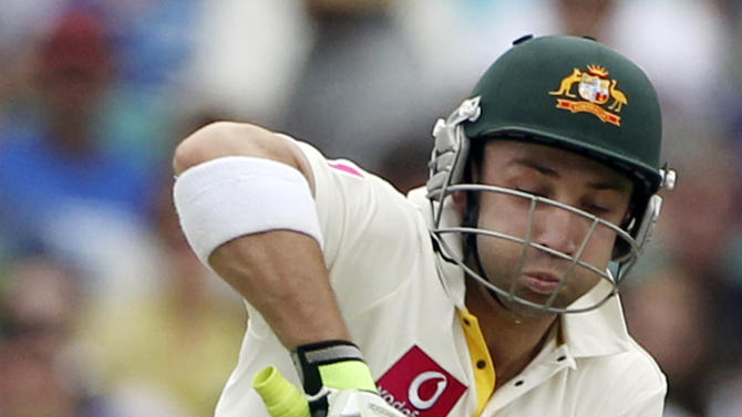 FILE - In this Jan. 3, 2011 file photo, Australian batsman Phillip Hughes receives the ball on his body as he plays at the ball against England on the first day's play of their fifth and final Ashes cricket test at the Sydney Cricket Ground in Sydney, Australia. Test batsman Hughes died in a Sydney hospital on Thursday, Nov. 27, 2014, two days after being struck in the head by a cricket ball during a domestic first-class match. He was 25. (AP Photo/Mark Baker, File)