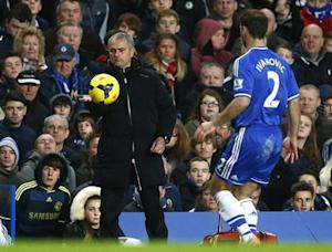 Chelsea manager Mourinho pats the ball to Ivanovic during their English Premier League soccer match against Crystal Palace at Stamford Bridge, London