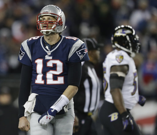 New England Patriots quarterback Tom Brady looks up at the scoreboard during the second half of the NFL football AFC Championship football game against the Baltimore Ravens in Foxborough, Mass., Sunday, Jan. 20, 2013. (AP Photo/Steven Senne)