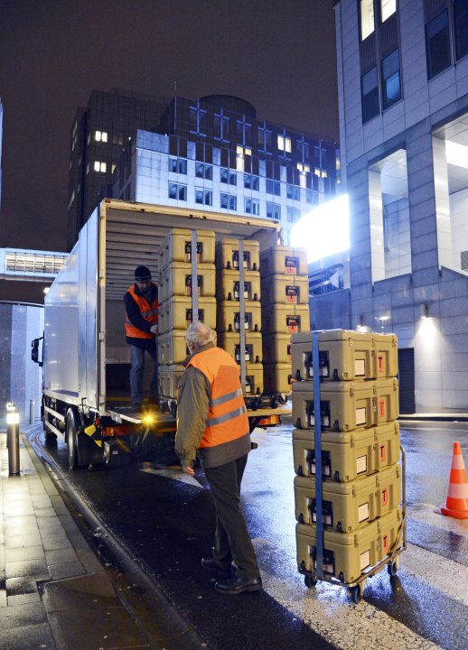 FOR STORY - EUROPE'S TRAVELING PARLIAMENT - Workmen load boxes onto a truck outside the European Parliament building, in Brussels on Friday, Feb. 1, 2013, ready for transportation to Strasbourg in Fra