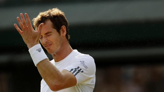 Andy Murray of Britain reacts during his Men's second round singles match against Lu Yen-Hsun of Taiwan at the All England Lawn Tennis Championships in Wimbledon, London, Wednesday, June 26, 2013. (AP Photo/Sang Tan)