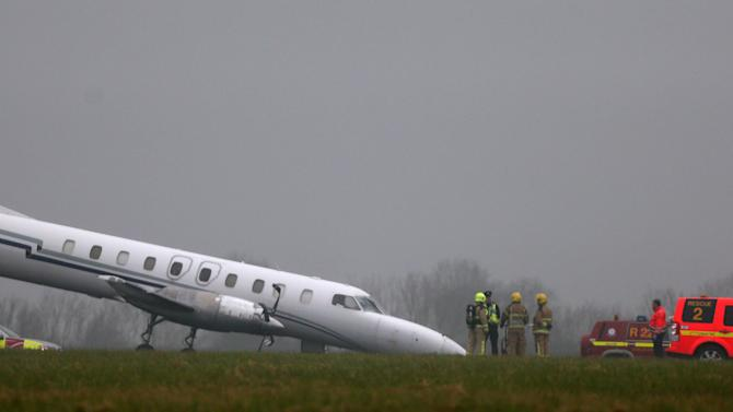 The scene of a plane crash at Dublin Airport after the front wheel of the Bin Air aircraft buckled on landing causing the accident on the runway, Thursday March 7, 2013. Neither the pilot nor co-pilot, the only crew, suffered injuries, an airport spokeswoman said. (AP Photo/ Niall Carson, PA)UNITED KINGDOM OUT  NO SALES  NO ARCHIVE