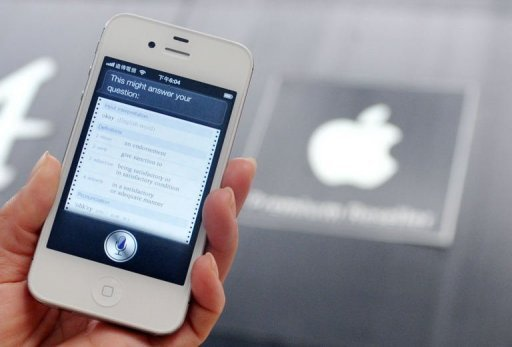 "A woman displays ""Siri"" voice-activated assistant technology, on an Apple iPhone 4S"