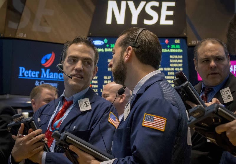 Wall St. falls from records, led by technology stocks
