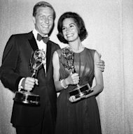 FILE - Dick Van Dyke, left, and Mary Tyler Moore co-stars of The Dick Van Dyke Show pose backstage at the Palladium with the Emmys won in the Television Academy&#39;s 16th annual awards show, in Los Angeles, Calif. They won the Emmy Award for best actor and actress in a series. Van Dyke is the recipient of the Life Achievement Award at the upcoming 19th Annual SAG Awards ceremony on Sunday, Jan. 27, 2013. (AP Photo, File)