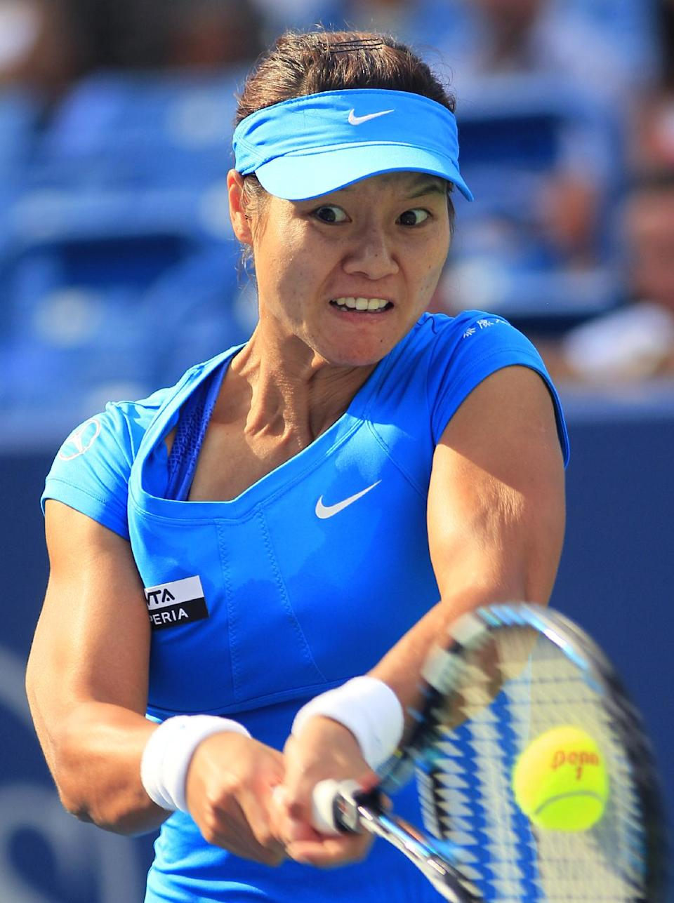 Li Na, from China, hits a backhand against Angelique Kerber, from Germany, during the women's final at the Western & Southern Open tennis tournament, Sunday, Aug. 19, 2012, in Mason, Ohio. Li won 1-6, 6-3, 6-1. (AP Photo/Al Behrman)