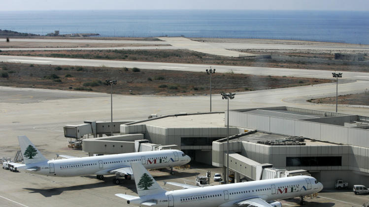 "In this Oct. 7, 2005 photo, Lebanon's Middle East Airlines airplanes are parked at Rafik Hariri international airport, in Beirut, Lebanon. Lebanon's national airline says it has disciplined an employee after a passenger complained on Facebook and Twitter that ground staff singled out passengers from the Philippines at the Beirut airport and told them over the loudspeaker: ""Filipino people, stop talking."" (AP Photo/Hussein Malla)"