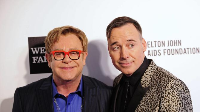 File picture of musician Elton John and his partner, producer David Furnish, in West Hollywood