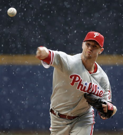 Kendrick pitches Phils past Brewers on rainy day