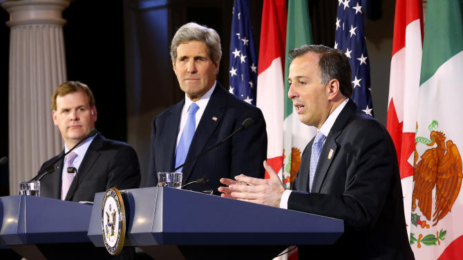 U.S. Secretary of State John Kerry, center, listens with Canadian Foreign Minister John Baird, left, as Mexican Foreign Secretary Jose Antonio Meade speaks during a news conference at Faneuil Hall in Boston Saturday, Jan. 31, 2015. (AP Photo/Winslow Townson)