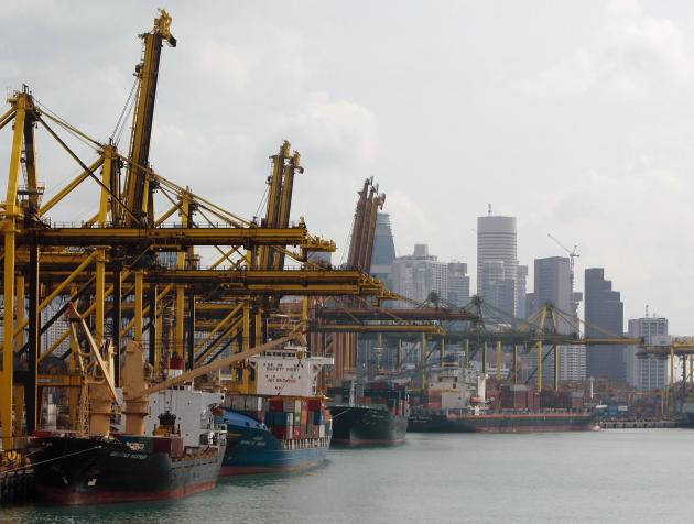 File photo shows container ships berthed at the Brani container terminal near Singapore's financial district