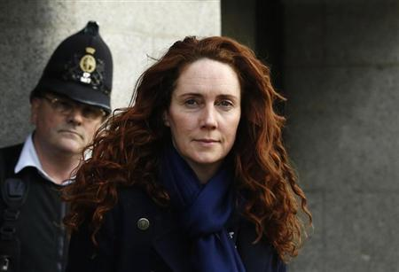 Former News International chief executive Rebekah Brooks leaves the Old Bailey courthouse in London