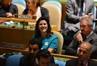 Luxembourg's Ambassador to the UN Sylvie Lucas (C) reacts after coming in second during the United Nations General Assembly session as they the vote for five countries to become non-permanent members of the UN Security Council for the years 2013-2014 at UN headquarters in New York. Rwanda, Argentina, Australia, South Korea and Luxembourg won non-permanent seats