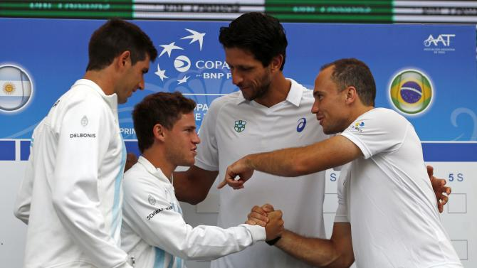 Argentina's Delbonis and Schwartzman talk to Brazil's Melo and Soares during the official draw for their upcoming Davis Cup tennis match in Buenos Aires