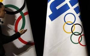 A technician gestures before the opening ceremony of the 126th IOC session in Sochi