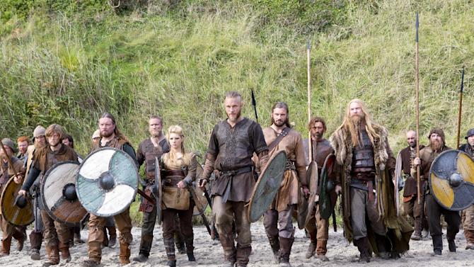 """This image released by History shows Travis Fimmel as Ragnar, center, in a scene from """"Vikings,"""" premiering Sunday, March 3 on History. (AP Photo/History, Jonathan Hession)"""