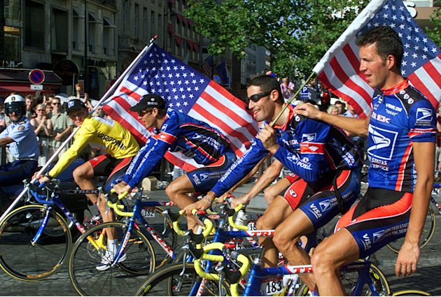 This July 25, 1999,  file photo shows Tour de France winner Lance Armstrong of the U.S. left, riding down the Champs Elysees avenue with teammates, from left,  Frankie Andreu,  of the U.S., George Hin