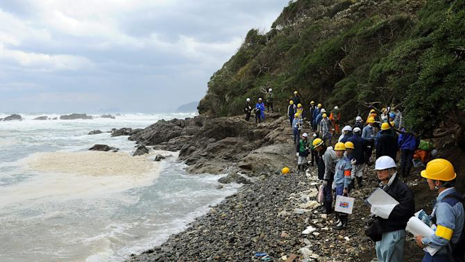 Japanese nuclear regulators examine the beach at the Ohi nuclear power plant in Ohi, Fukui prefecture, western Japan, Friday, Nov. 2, 2012. They inspected ground structures at the country's only operating nuclear plant to examine if an existing fault line is active. The inspection determines whether the Ohi plant should close. Its No. 3 and No. 4 reactors went back online in July, becoming Japan's only operating reactors after all 50 Japanese reactors went offline for inspection following the March 11, 2011, crisis at Fukushima Dai-ichi. (AP Photo/Kyodo News) JAPAN OUT, MANDATORY CREDIT, NO LICENSING IN CHINA, FRANCE, HONG KONG, JAPAN AND SOUTH KOREA