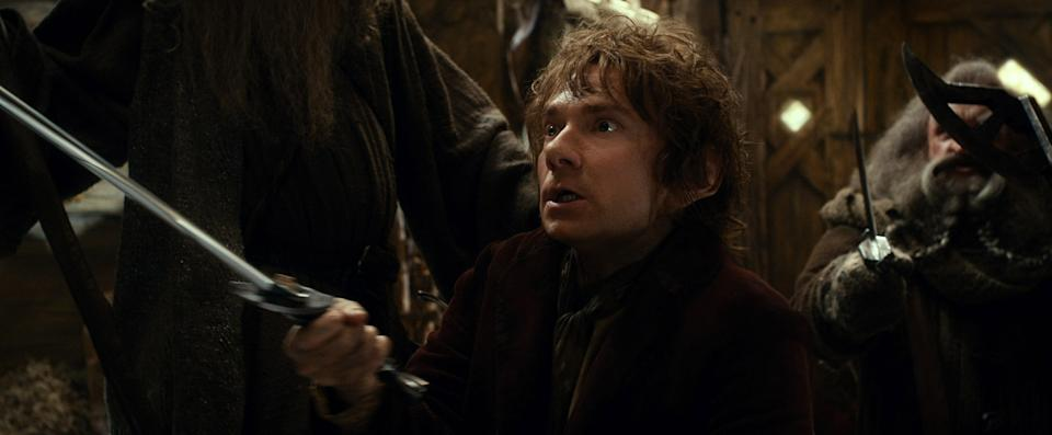 "This film image released by Warner Bros. Pictures shows Martin Freeman as Bilbo Baggins in a scene from ""The Hobbit: The Desolation of Smaug."" (AP Photo/Warner Bros. Pictures)"