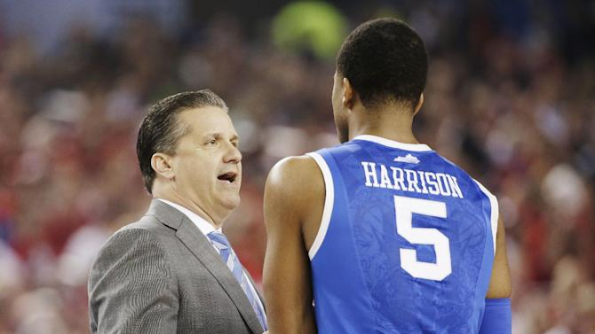 Kentucky head coach John Calipari talks with guard Andrew Harrison (5) during the first half of the NCAA Final Four tournament college basketball semifinal game against Wisconsin Saturday, April 5, 2014, in Arlington, Texas