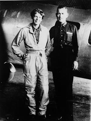 FILE-- In a 1937 file photo aviator Amelia Earhart and her navigator, Fred Noonan, pose in front of their twin-engine Lockheed Electra in Los Angeles prior to their historic flight in which Earhart was attempting to become first female pilot to circle the globe.  A $2.2 million expedition is hoping to finally solve one of America's most enduring mysteries. What happened to famed aviator Amelia Earhart when she went missing over the South Pacific 75 years ago? (AP Photo, File)