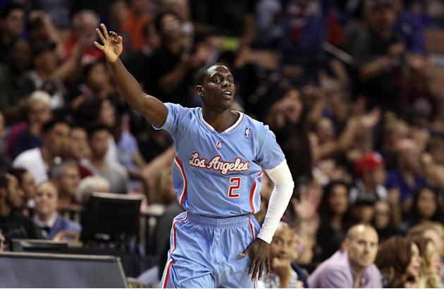 The Los Angeles Clippers' Darren Collison celebrates after sinking a 3-point shot during overtime of a preseason NBA basketball game against the Denver Nuggets on Saturday, Oct. 19, 2013, in Las Vegas
